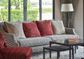 Modern living room with red pillows on sofa and dacorativ Royalty Free Stock Photo