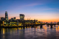 Modern london morning photo with offices by the river thames and illuminated towers Royalty Free Stock Photography