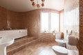 Modern luxury bathroom with bathtub and window. Interior design. Royalty Free Stock Photo
