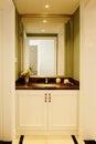 Modern luxury bathroom with big mirror in european style Royalty Free Stock Photo
