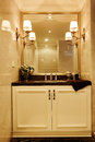 Modern luxury washroom with big mirror in european style Stock Images