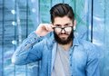 Modern man with beard and glasses Royalty Free Stock Photo