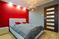 Modern master bedroom red interior Stock Photos