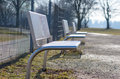 Modern metal benches in park Royalty Free Stock Photo