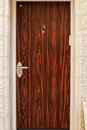 Modern metal brown door With wooden a beautiful vintage background Royalty Free Stock Photo