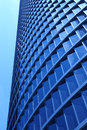 Modern metallic and glass building facade in blue tone Royalty Free Stock Photo