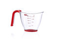 Modern metric measuring cup isolated on white Royalty Free Stock Photo