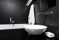 Modern minimalism style bathroom interior in black Stock Image