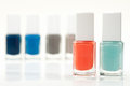 Modern nail polish two bright bottles with others on background Stock Photo