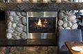 Modern and natural fireplace Stock Photography