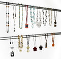 Modern necklaces hanged on a metallic tube horizontal Royalty Free Stock Images