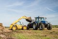 Modern New Holland tractor Tractor spreading manure on fields Royalty Free Stock Photo