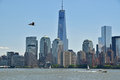 Modern new york city viewed from liberty state park across hudson river on a sunny day with bird flying and freedom tower being Royalty Free Stock Photo