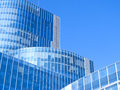 Modern office building blue glass facade futuristic Stock Photos