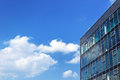 Modern office building on a cloudy sky background Royalty Free Stock Photo