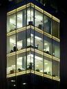 modern office building illuminated at night with geometric windows Royalty Free Stock Photo