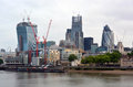 Modern office buildings including the gherkin on the thames rive st mary axe in london financial district banks of river Royalty Free Stock Photography