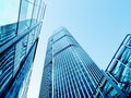 Modern office buildings from low angle view shot of glass city Royalty Free Stock Photo
