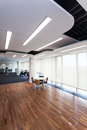 Modern office with design lighting and wooden floor Royalty Free Stock Photography