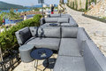 Modern outdoor bar with grey sofas in a luxury hotel