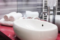 Modern oval sink in bathroom white clean white towels the background Royalty Free Stock Photos