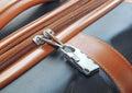 Modern padlock closeup on brown suitcase Royalty Free Stock Photo