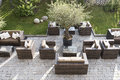 Modern patio garden with tables and chairs Stock Photos