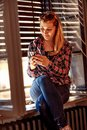 Modern people city lifestyle. urban girl holding a cellphone and Royalty Free Stock Photo