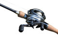 Modern powerful fishing reel spinning on white background Royalty Free Stock Photos