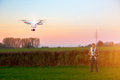 Modern RC UAV Drone / Quadcopter with camera flying on a clear s Royalty Free Stock Photo