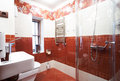 Modern red bathroom Stock Photos