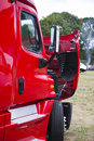 Modern red semi truck with open hood on parking lot Royalty Free Stock Photo