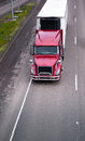 Modern red semi truck with refrigerator unit on reefer trailer d Royalty Free Stock Photo