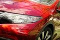 Modern red sport car headlight Royalty Free Stock Photo