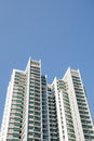 Modern residential condominium with clear blue sky Stock Photos