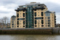 Modern riverside docklands housing on thames Stock Photography