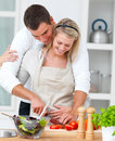 Modern romantic couple preparing a meal Stock Photos
