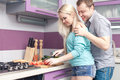 Modern romantic couple preparing meal together portrait of a happy breakfast woman is pregnant indoor shot Royalty Free Stock Photo