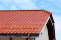 Modern roof of the red glazed ceramic tile Royalty Free Stock Photo