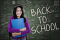Modern school student back to school portrait of smiling female with casual clothes and standing in the class Royalty Free Stock Photography