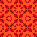 Modern seamless pattern of red shades geometrical objects on orange background Royalty Free Stock Photo