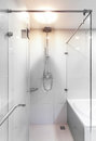 Modern shower with water stream beautiful walk in white tiles Stock Photos