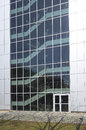Modern silver building big glass Stock Photos