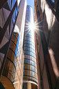 Modern skyscraper with sun flare, sun star reflected from the gl Royalty Free Stock Photo