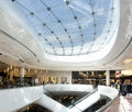 Modern sleek shopping architecture in mall Royalty Free Stock Images