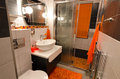 Modern small bathroom interior in orange and brown colors Royalty Free Stock Photography