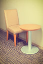 Modern sofa chair and table in hotel room Royalty Free Stock Photo