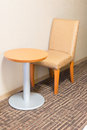 Modern sofa chair and table in hotel room for a single person. Royalty Free Stock Photo