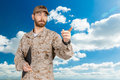 Modern soldier in military uniform with clipboard pointing Stock Photos
