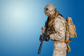 Modern soldier in uniform with gun Royalty Free Stock Image